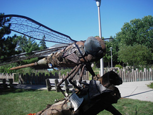 Photo of the found object sculpture called Dragon Fly, when exhibited at the 2006 Minnesota State fair.