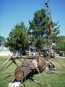 Photo of the found object sculpture called the Industrious, Cooperative Ant, when exhibited at the 2008 Minnesota State fair.