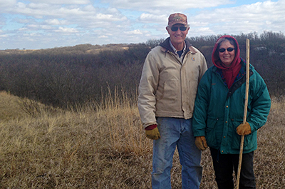 Photo of Larry and Pat Wahl on their land
