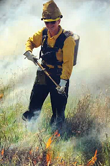 Photo of Kristi Loobeek on the fire line.