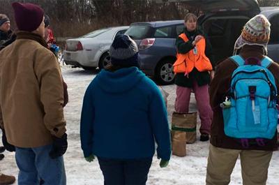 Photo of Larissa Mottl addressing volunteer group