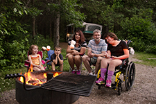 A group of people sitting around a campfire