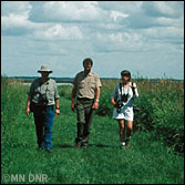 Landowners touring their land with a DNR specialist to plan habitat management.