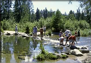 people walking across Mississippi River Headwaters