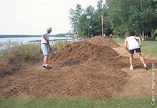 workers spreading mulch