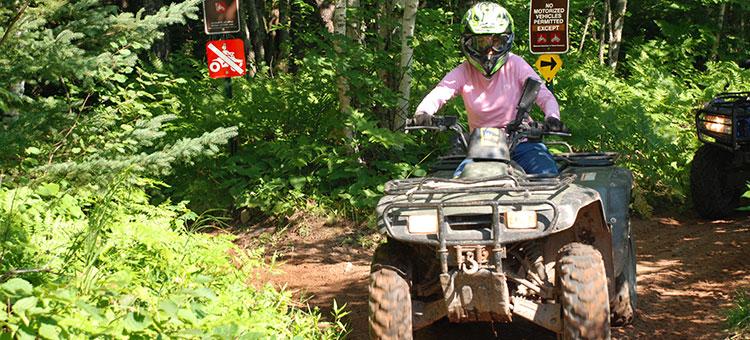 woman riding an ATV