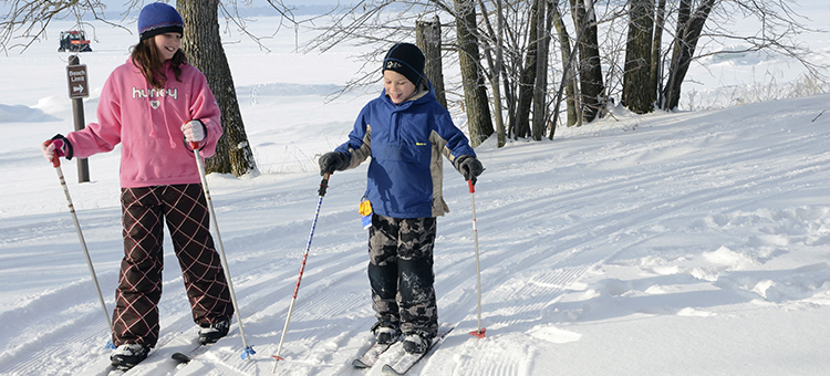 Children cross-country skiing.