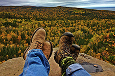 Hiking shoes and a view over a state park