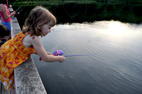 Girl fishing from pier