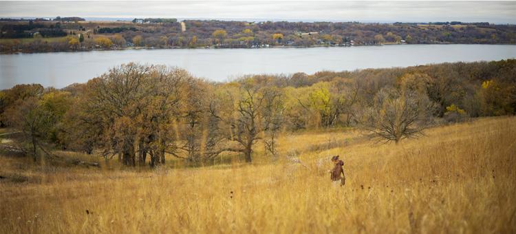 Walking though fall grasses at Bonanza Prairie