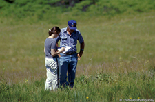 Landowner speaking with SNA staff on native prairie