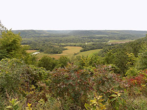 overlook of Whitewater Valley showing open pature and red sumac