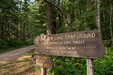 wooden sign with text Thistledew lake campground. George Washington State Forest