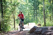 Smiling children riding mountain bikes