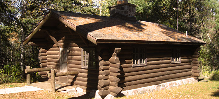 Photo of the CCC cabin at Scenic State Park