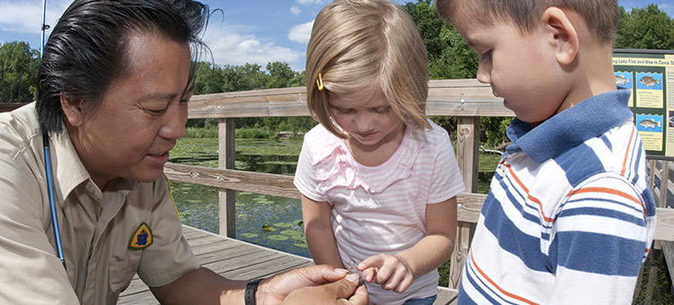 Children learn to fish in a state park.