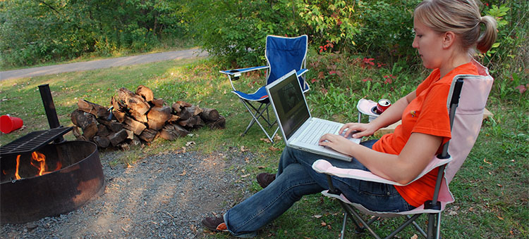 Woman using wifi in a state park and other parks that offer wi-fi/internet services