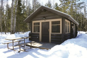 Photo of a rustic park camper cabin in winter.
