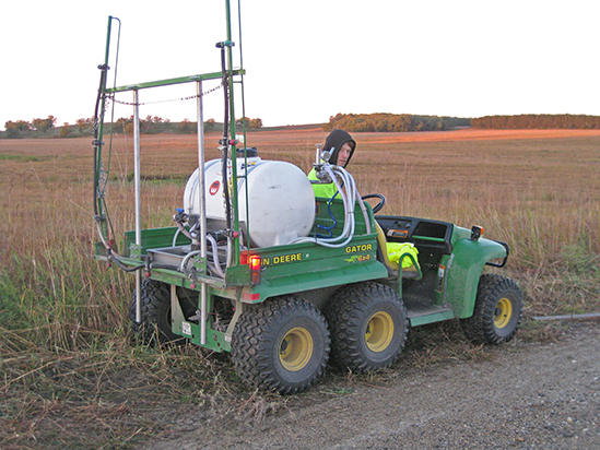 A tank sprayer mounted on an ATV.