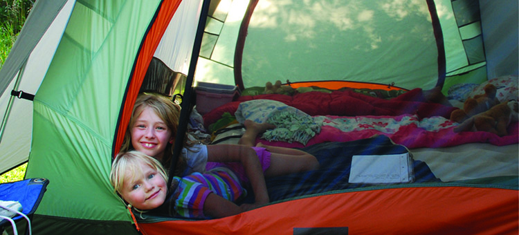 Picture of two children in a tent