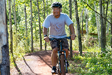 smiling man on mountain bike