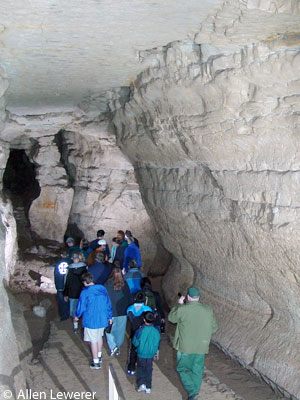 Photo: A group of visitors follow a naturalist into Mystery Cave for one of the two-hour tours. Image copyright Allen Lewerer.