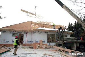 The final roof trusses go up