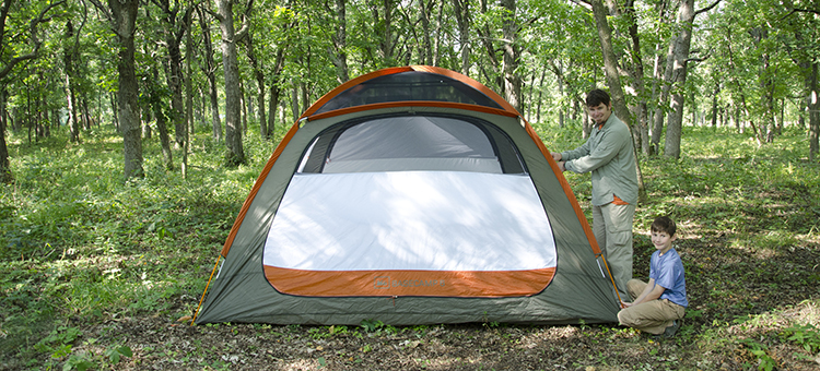 Parent and child camping in a state park