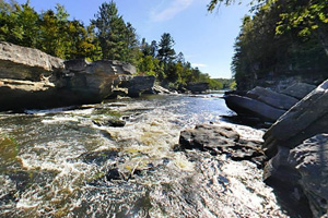Photo of the Hell's Gate Rapids, tumbling over sheer ledges on the Kettle River.