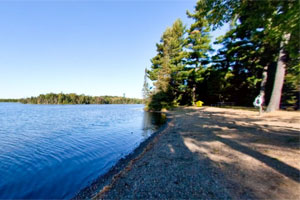 Photo of swimming beach at Bear Head Lake State Park.
