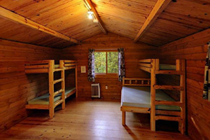 Photo of the interior of this camper cabin sleeping area.