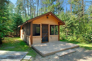Photo of one of the camper cabins, some large enough to offer space to sleep six.