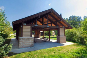 Photo of the picnic shelter offering a nearby pedestal grill, recycling station, vault toilets, and a self-registration visitor kiosk on Ludlow Island.