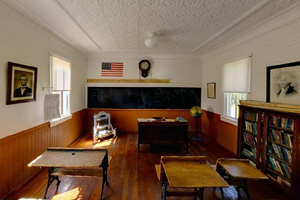 Photo of the interior of a historic schoolhouse, located on the grounds of the Sam Brown Monument Wayside.