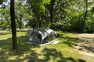Photo the of tent-only sites, all within close walking distance to the nature center, the swimming beach and bathroom facilities.