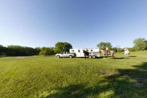 Photo of horse trailers and horseback riders using the horse campgrounds.