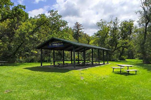 Photo of the picnic shelter and several picnic tables that offer an excellent spot to enjoy a meal.