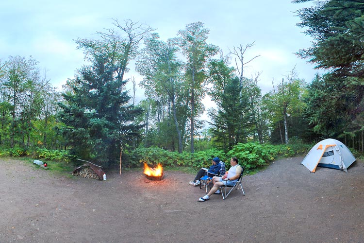 Photo of a campsite that offer a glimpse of Lake Superior, or a place to relax by the campfire.