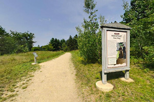 Photo of signs along the trail explaining Crow Wing State Park's fascinating history.
