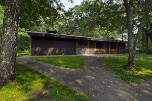 Photo of the park picnic shelter, tucked into the woods.