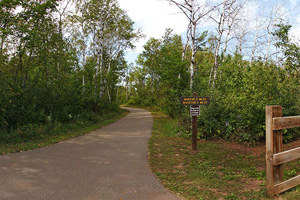 Photo of the the parking lot and the entrance of Cuyuna Lakes State Trail - East.