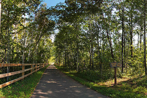 Photo of the the parking lot and the entrance of Cuyuna Lakes State Trail - West.