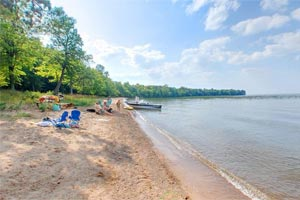 Photo of the west side of the swimming beach at Father Hennepin State Park.