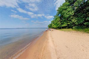 Photo of the quieter east side of the swimming beach at Father Hennepin State Park.