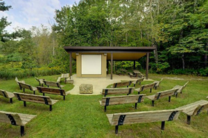 Photo of the campground amphitheater providing the perfect spot to enjoy interpretive programs on summer weekends.