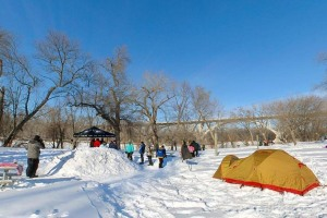 Photo of winter camping event outside the Picnic Island Shelter.