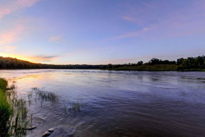 Photo of a beautiful sunset over the Rainy River.