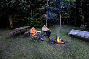 Photo of campers enjoying a campfire along the Rainy River.