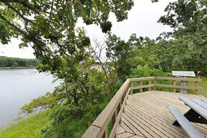 Photo of the wooden deck overlook featuring a view of Signalness (Mountain) Lake.