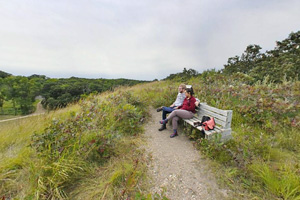 Photo of visitors enjoying views of the rolling landscape.